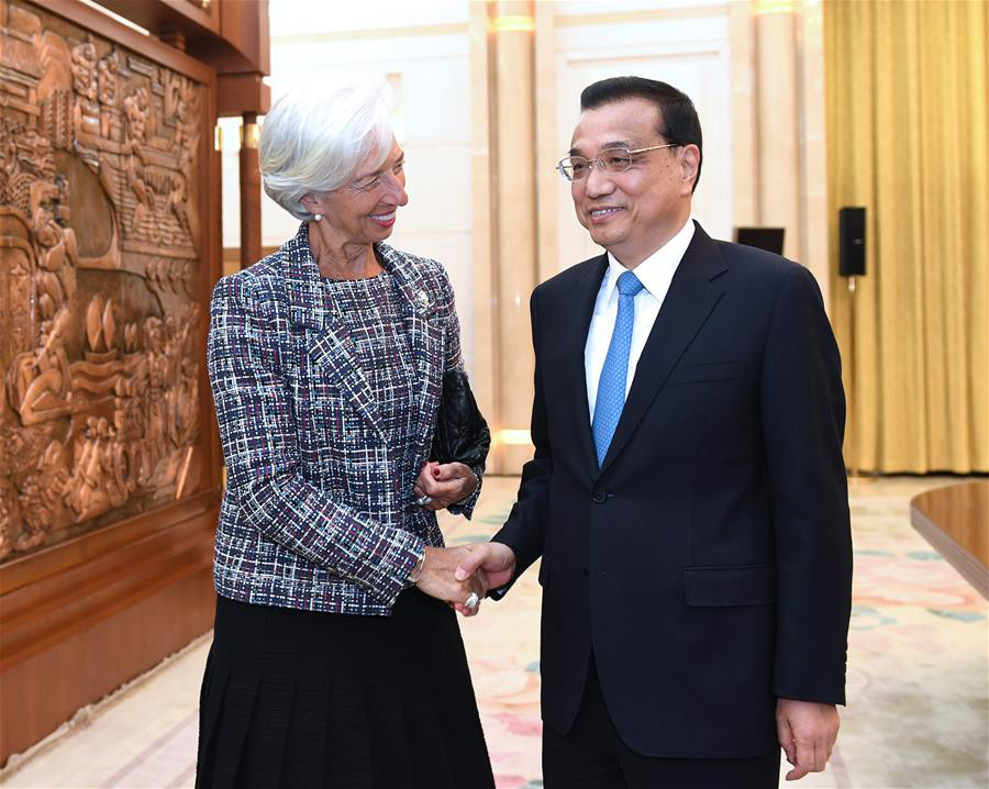 Chinese Premier Li Keqiang meets with Christine Lagarde, managing director of the International Monetary Fund (IMF), who is here for the Belt and Road Forum (BRF) for International Cooperation, at the Great Hall of the People in Beijing, capital of China, May 14, 2017. (Xinhua/Rao Aimin)