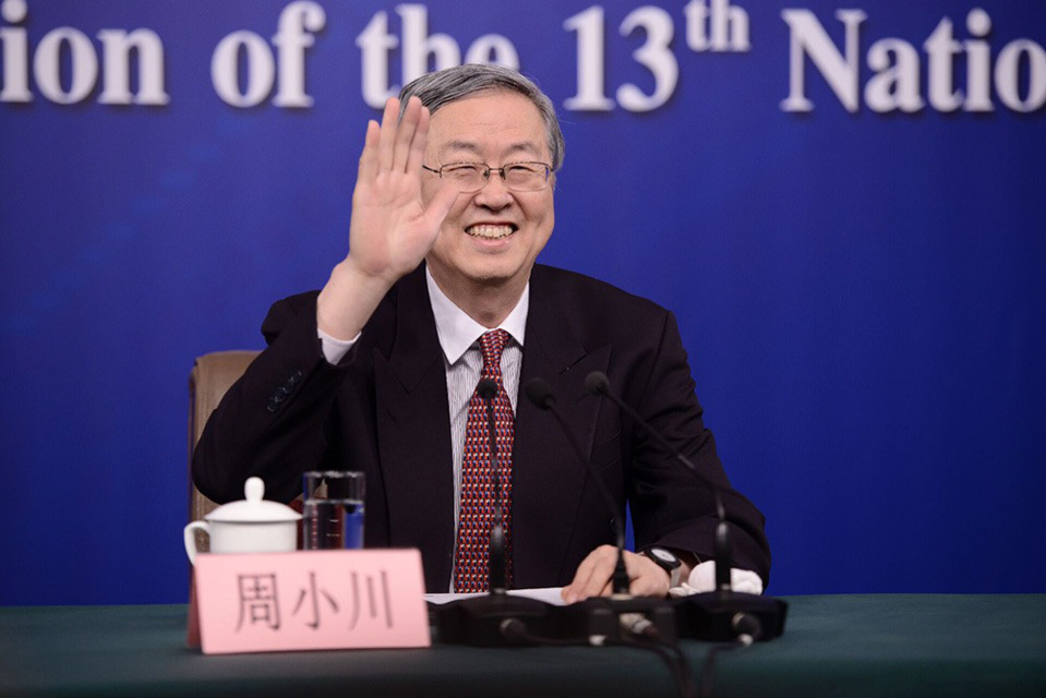 Zhou Xiaochuan, governor of the People's Bank of China, fields questions at a press conference on the sidelines of the first session of the 13th National People's Congress in Beijing, capital of China. (Photo by Zhang Qichuan from People's Daily Online)