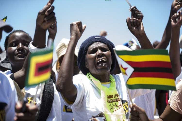 Supporters attend the Zimbabwe ruling party Zimbabwe African National Union-Patriotic Front (Zanu PF) youth interface rally in Bulawayo on November 4, 2017.  Image: ZINYANGE AUNTONY / AFP