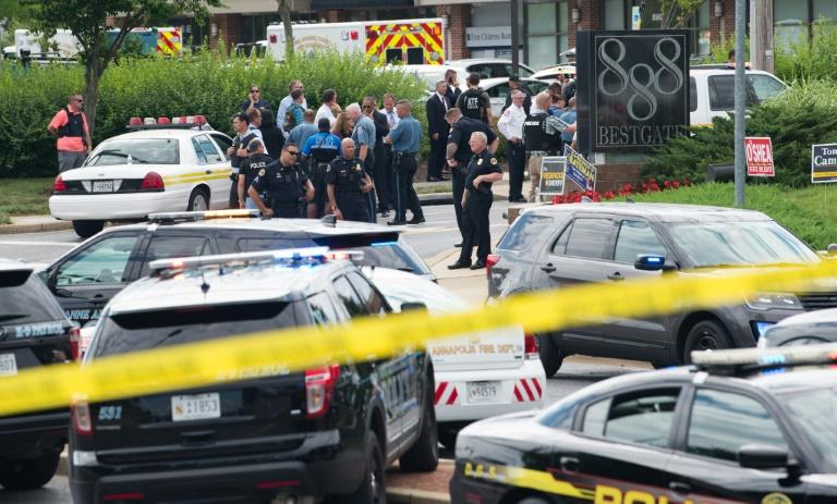 Des policiers devant les locaux du Capital Gazette à Annapolis, dans le Maryland, le 28 juin 2018 / © AFP / SAUL LOEB