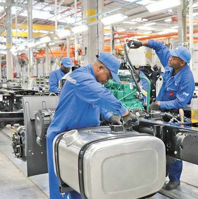 African employees work on an auto production line at a factory of China's FAW Group in city of Nelson Mandela Bay, South Africa. (Photo by Liu Lingling from People's Daily)