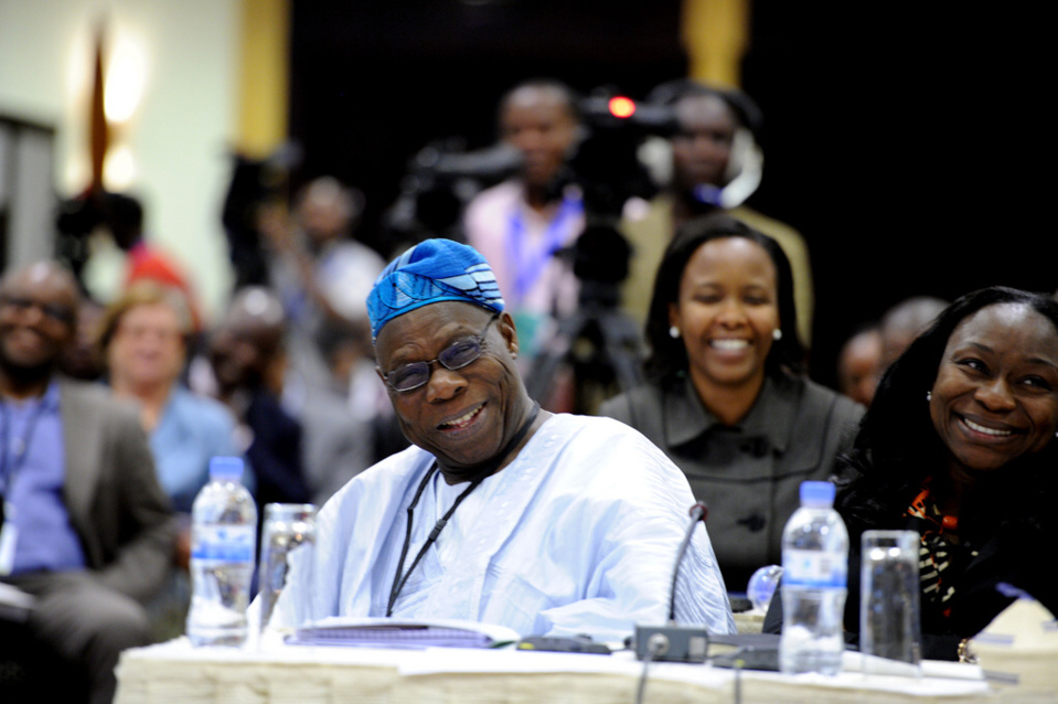 Former President of Nigeria, Olusegun Obasanjo and his daughter, Enitan Obasanjo share a light moment during the session. Behind them is C.E.O of Rwanda Development Bank, Clare Akamanzi.