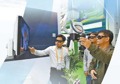 A visitor experiences intra-operative visual magnification system at the exhibition area for medical equipment and medical care products. Photo by Chen Bin from People's Daily