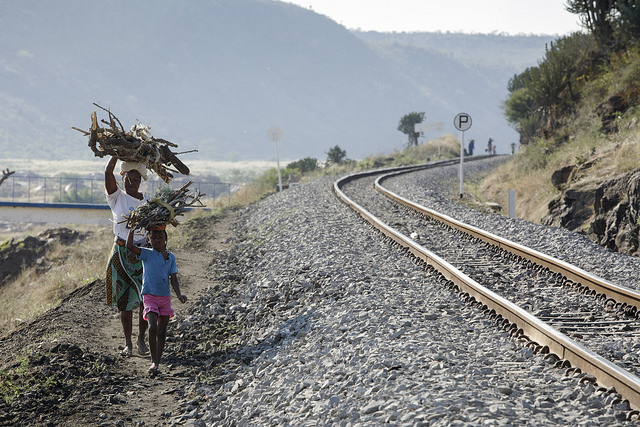 Walking along the main railway line near Ressano Garcia. Photo: John Hogg / World Bank