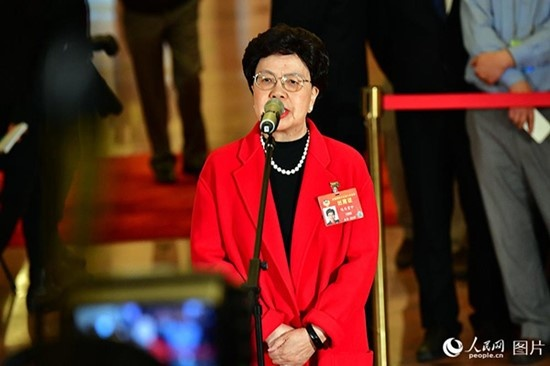 Margaret Chan Fung Fu-chun, a member of the 13th National Committee of the Chinese People's Political Consultative Conference (CPPCC), receives an interview ahead of the opening of the second session of the 13th CPPCC National Committee at the Great Hall of the People in Beijing, capital of China, March 3, 2019. (Photo by Yu Kai from People's Daily Online)