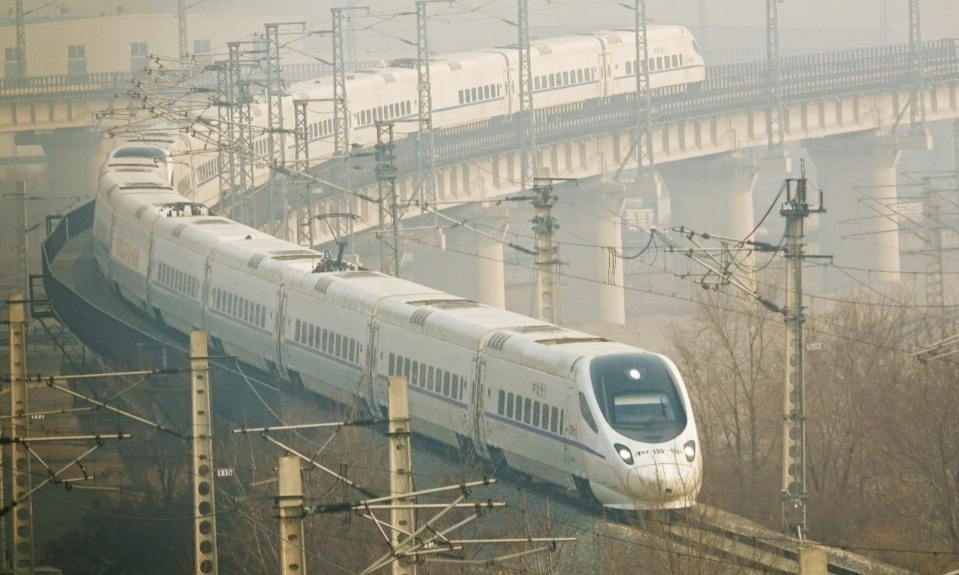 Photo taken on March 1, 2019 shows a bullet train running along a rail in Dalian, northeast China's Liaoning province. (Photo by Liu Debin from People's Daily Online)