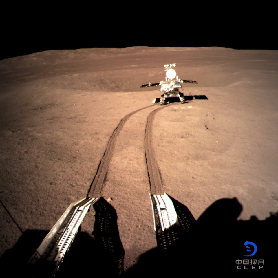 China National Space Administration on Jan. 4, 2019 released a photo taken by a camera installed on the lander of the Chang'e-4 probe, revealing the rover Yutu-2 and its traces at the planned landing site. (published by Xinhua, photo by China National Space Administration)