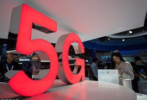 Visitors browse latest information about China's 5G technology at an event held in Guangzhou on March 1st. Photo: CFP