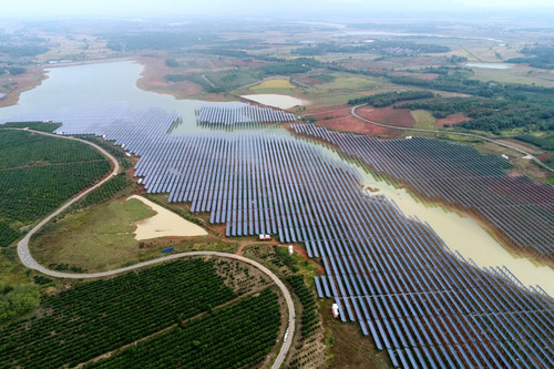 Photovoltaic solar panels collecting sunlight in Fengxin county, Yi Chun of southeastern China's Jiangxi province on Oct. 23, 2018. It is Jiangxi's first solar-aquaculture demonstration project that could save 29,700 tons of standard coal and reduce nearly 100,000 tons of air pollutants such as carbon dioxide per year. (Photo by Shi Yu, Source: People's Daily online)