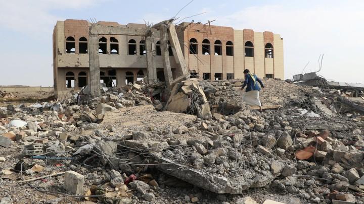 A man walks through the rubble of an air strike on a college in Saada, Yemen.NAIF RAHMA / REUTERS