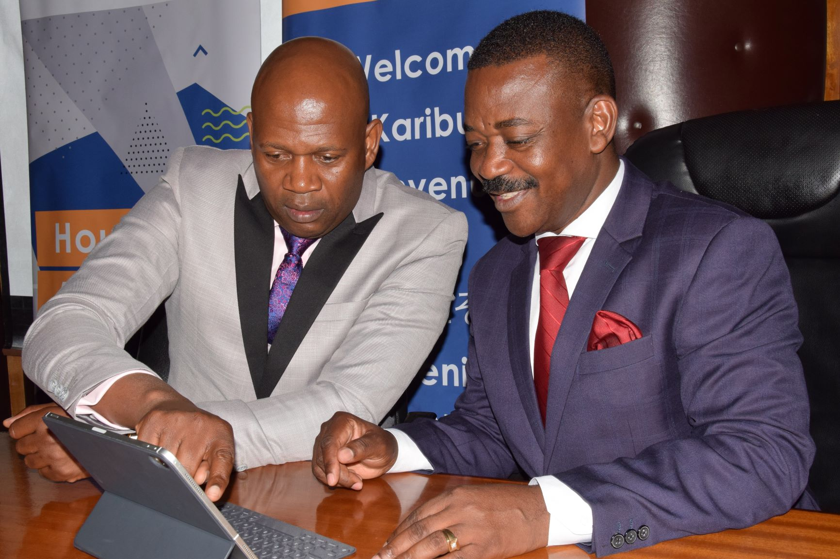 Shelter Afrique Managing Director Andrew Chimphondah (left) explains financials results to Shelter Afrique Chairman Nghidinua Daniel when the Company released its 2019 half year result last month.