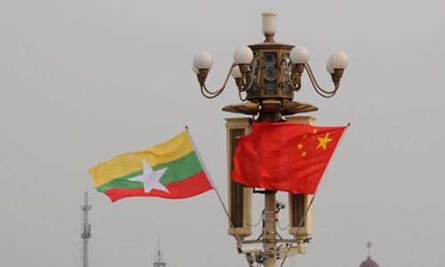 The national flags of China and Myanmar. (Photo from CFP)