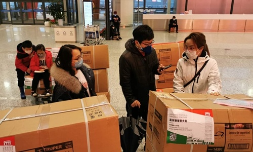 Wenzhou volunteers help transport donations related to COVID-19 for Italy. Photo: courtesy of Blazing Youth