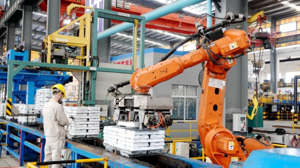 A robotic arm stacks zinc ingot products at a workshop of Nandan Nanfang Non-ferrous Metals Smelting Co. in Nandan county, south China's Guangxi Zhuang Autonomous Region, March 1, 2020. Gao Dongfeng/People's Daily Online