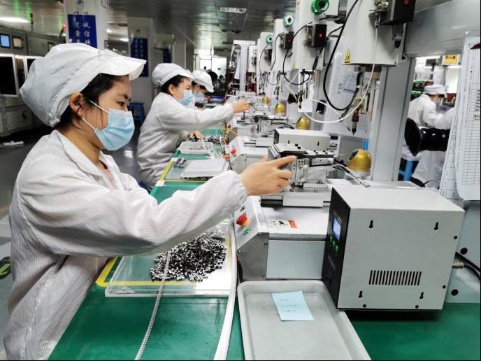 Workers are busy at a factory of an electronics company in Leqing, a county-level city in Wenzhou, east China's Zhejiang province to complete orders for mini motors placed by foreign clients, March 10, 2020. Cai Kuanyuan/People's Daily Online