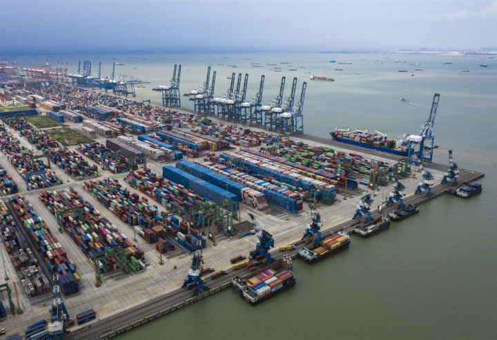 Photo taken on May 10 shows a busy scene at a container wharf of Longxue Island, Nansha district, south China's city of Guangzhou. Photo by Qiu Xinsheng/People's Daily Online
