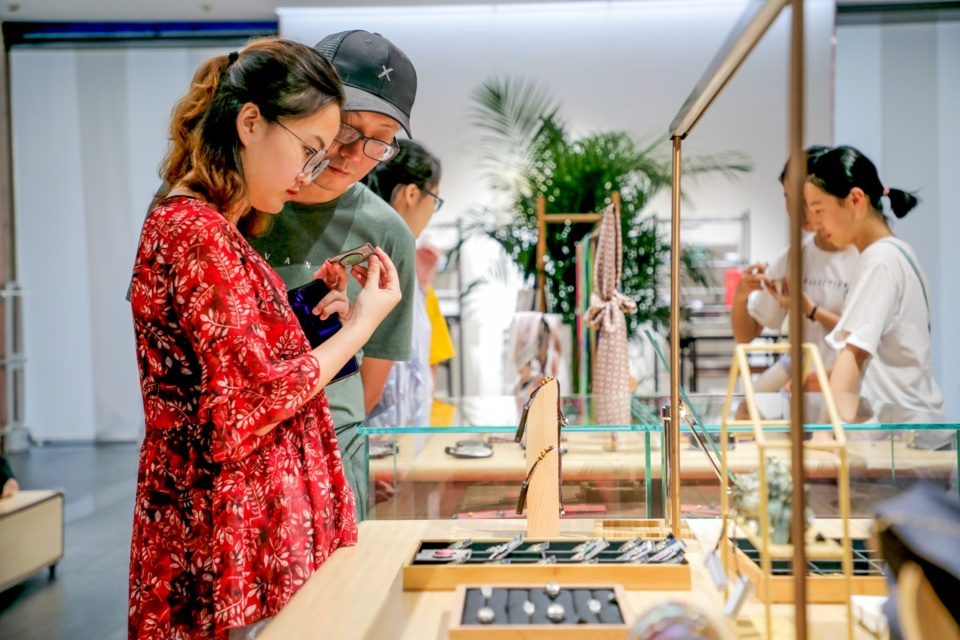 Visitors select cultural and creative products in the shop of Shanxi Bronze Museum. File photo