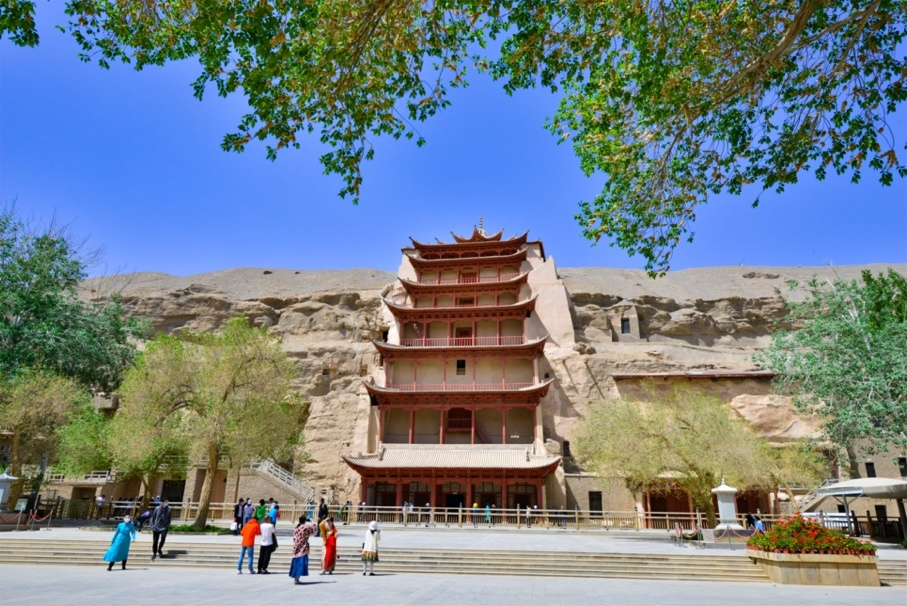 Tourists visit the Mogao Grottoes on May 10, the day it reopens. Photo by Wang Binyin/People's Daily Online