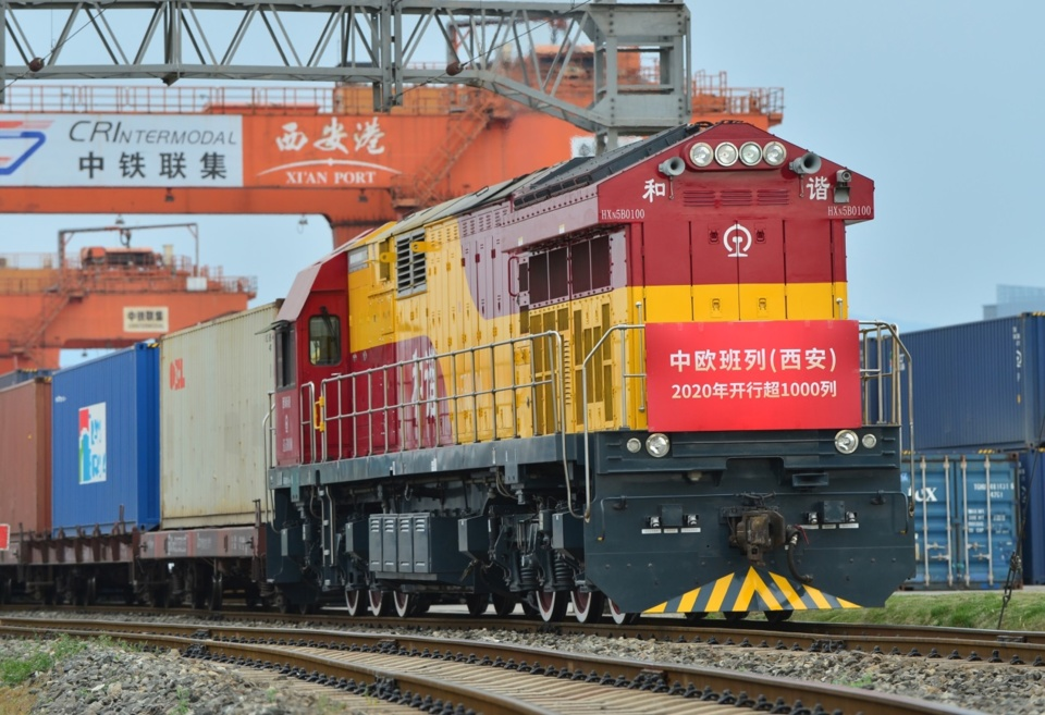 China-Europe freight train X9003 leaves Xi'an, Northwest China's Shaanxi Province for Uzbekistan, carrying 49 containers of refrigerators, tea, lamps, and air compressors, May 6. Photo by Tang Zhenjiang/People's Daily Online