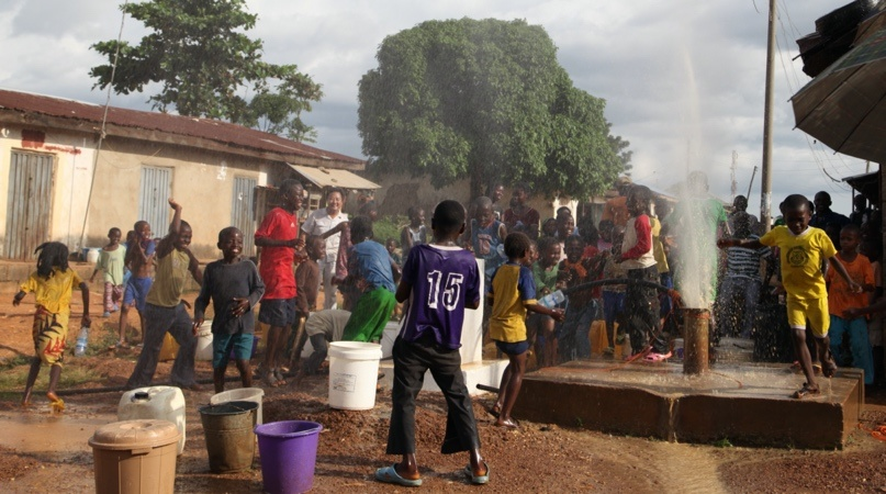 Children play around a well in Kwali, Nigeria when CGCOC employees clean the well. Photo: courtesy of the CGCOC