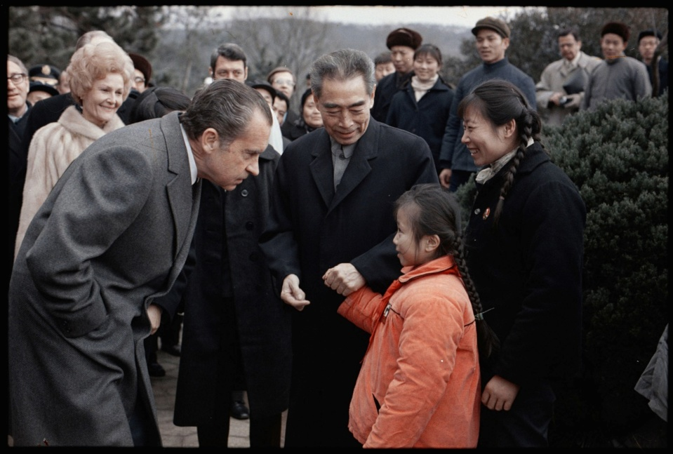 Chinese Premier Zhou Enlai and U.S. President Richard Nixon greet a young girl at Hangzhou West Lake park in China, February 26, 1972. (Photo from the website of the Richard Nixon Presidential Library and Museum)