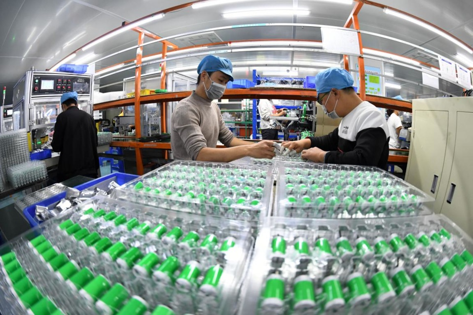 Workers are busy producing lithium-ion batteries in a company in Yichun, east China's Jiangxi province, Dec. 2, 2020. (Photo by Zhou Liang/People's Daily Online)