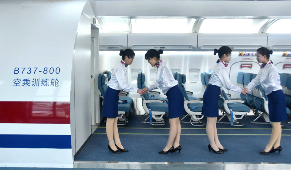 Students attend an airline etiquette class at a vocational education center in Yongnian district, Handan, north China's Hebei province, Nov. 26, 2020. (Photo by Hu Gaolei/People's Daily Online)
