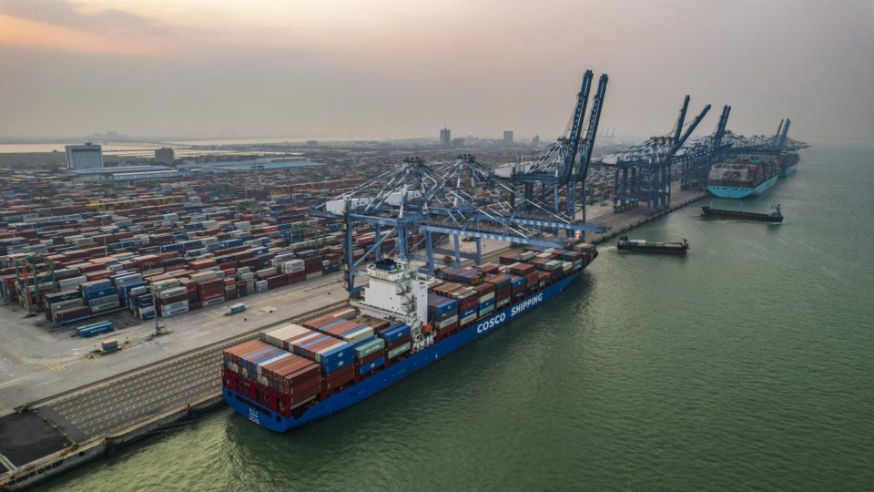 Containers are loaded onto a cargo ship at a terminal in Nansha district, Guangzhou, capital of south China's Guangdong province, Sept. 12, 2021. (Photo by Ye Bingxin/People's Daily Online)
