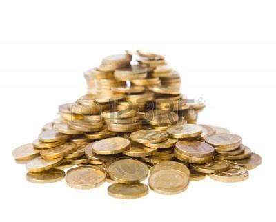Tas de pièces de monnaie. Les richesses et le bien-être de concept. Isolé sur un fond blanc. Crédit photo : 123rf.com