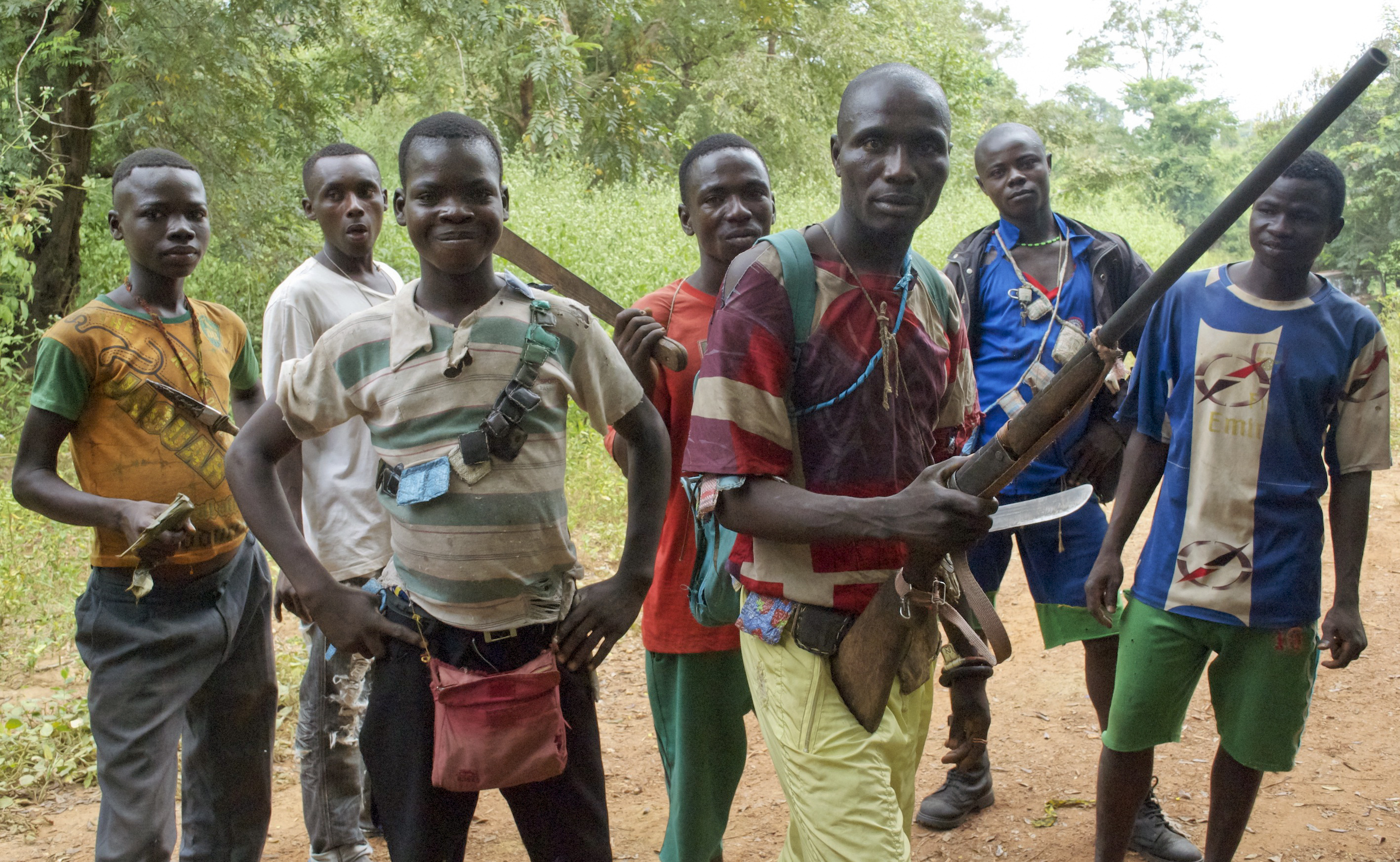 Fighters from a Christian militia known as the anti-balaka have emerged to defend towns and in some cases attack Muslim communities. These men display their makeshift weaponry in Boubou, Central African Republic, on Nov. 26. Florence Richard